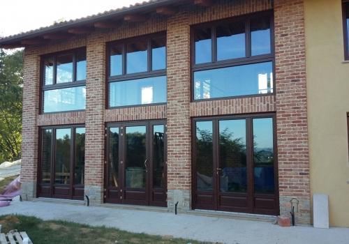 Finestroni e porte balconi legno/alluminio